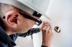 man performing a home inspection